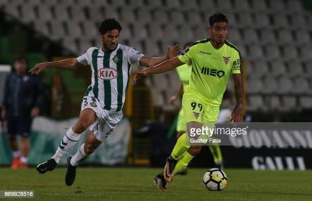 Aves forward Cristian Arango from Colombia with Vitoria Setubal forward Vasco Costa from Portugal in action during the Primeira Liga match between...