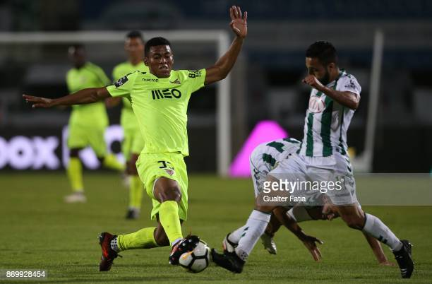 Aves forward Derley from Brazil with Vitoria Setubal midfielder Joao Costinha from Portugal in action during the Primeira Liga match between Vitoria...