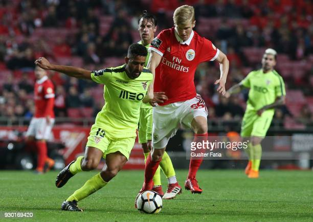 Aves midfielder Fernando Tissone competes with SL Benfica midfielder Keaton Parks during the Primeira Liga match between SL Benfica and CD Aves at...