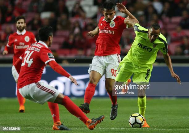 Aves midfielder Nildo Petrofina from Brazil tackled by SL Benfica midfielder Joao Carvalho from Portugal during the Primeira Liga match between SL...