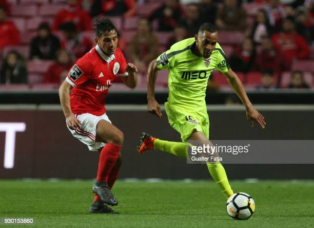 Aves midfielder Nildo Petrofina from Brazil with SL Benfica forward Rafa Silva from Portugal in action during the Primeira Liga match between SL...
