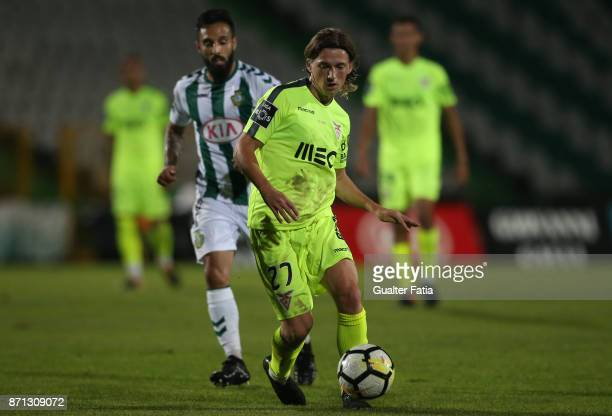 Aves midfielder Ryan Gauld from Scotland with Vitoria Setubal midfielder Joao Costinha from Portugal in action during the Primeira Liga match between...