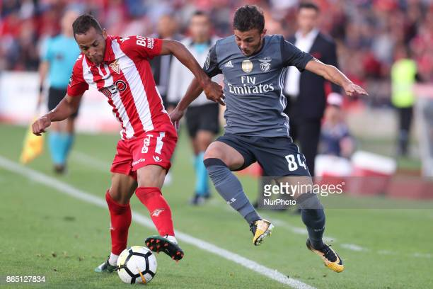 Avess player Nildo with Benfica's Portuguese forward Diogo Goncalves during the Premier League 2017/18 match between CD Aves and SL Benfica at...