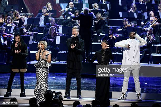 Avi Kaplan Kirstie Maldonado Scott Hoying Mitch Grassi and Kevin Olusola of the band Pentatonix perform onstage at the 2015 American Music Awards at...