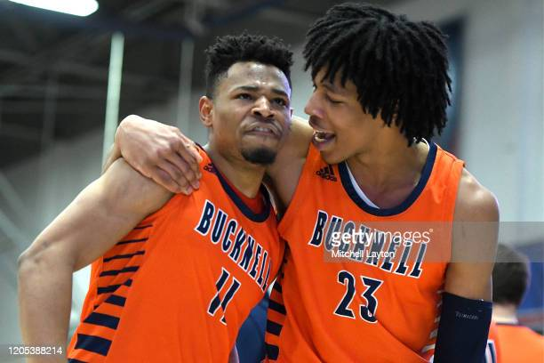 Avi Toomer and Kahliel Spear of the Bucknell Bison celebrate a win after a Patriot League Basketball Tournament college basketball game against the...