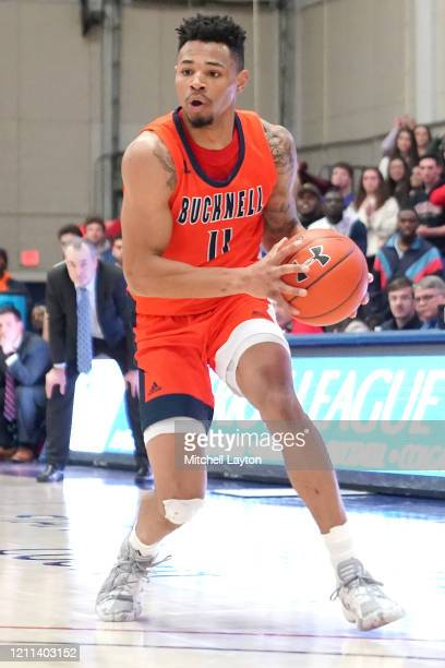Avi Toomer of the Bucknell Bison looks to pass the ball during a Patriot League Quarterfinal Basketball Tournament college basketball game against...