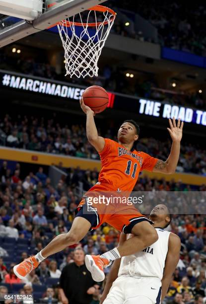 Avi Toomer of the Bucknell Bison shoots the ball against the West Virginia Mountaineers in the first half during the first round of the 2017 NCAA...