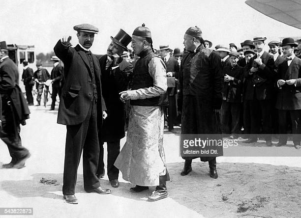 Aviation beginnings France IssylesMoulineaux Louis Bleriot gives explanations to the leader of a chinese delegation prince TsaiTao Photo M Rol