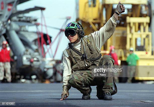 Aviation Electricians Mate 3Rd Class Richard Lim Of San Francisco, Ca Acknowledges Final Checks On An Aircraft Before It Leaves The Flight Deck Of...