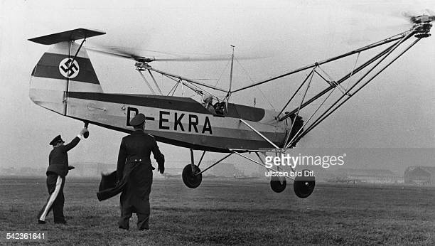 Aviation, Helicopters - Ernst Udet holds with one hand the helicopter Focke-Wulf Fw 61 V 2 D-EKRA, in which Hanna Reitsch starts a flight from Bremen...