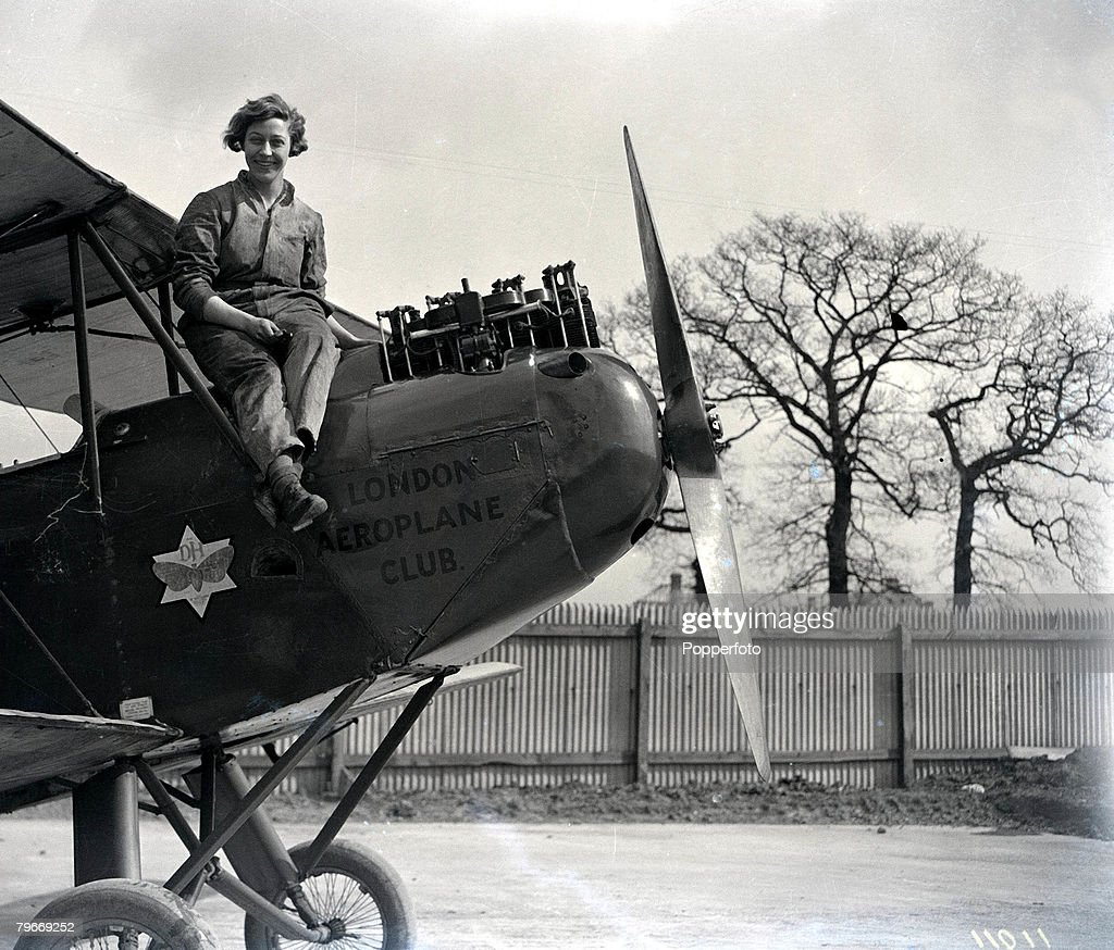 "Aviation, London, 30th March, 1930, English pilot Miss Amy Johnson pictured resting from working on the engine of her De Havilland ""Moth"" aeroplane at Stag Lane airport in Hendon prior to her attempt to break the England-Australia flight record, She is th : News Photo"