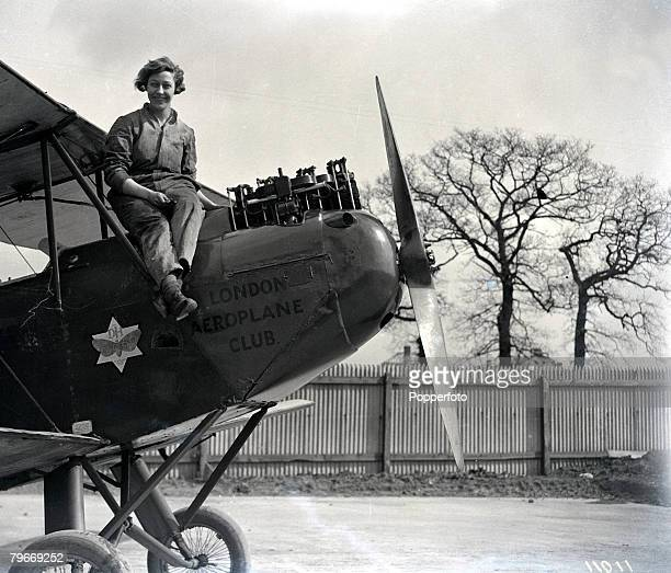 Aviation London 30th March English pilot Miss Amy Johnson pictured resting from working on the engine of her De Havilland 'Moth' aeroplane at Stag...