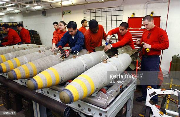 Aviation Ordnancemen assemble 2000lb GBU12 laser guided bombs aboard USS Theodore Roosevelt before they are sent to the aircraft carrier's flight...