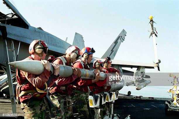 Aviation Ordnancemen Load An Aim120 Advanced MediumRange AirToAir Missile On The Wing Of An F/A18 'Hornet' Strike Fighter October 24 2001 Aboard The...