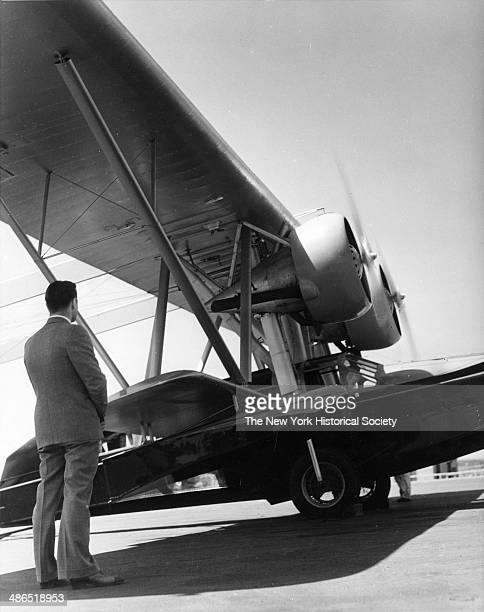 Aviation pioneer Howard Hughes viewing a Sikorsky S-38 amphibious flying boat, New York, 1930.