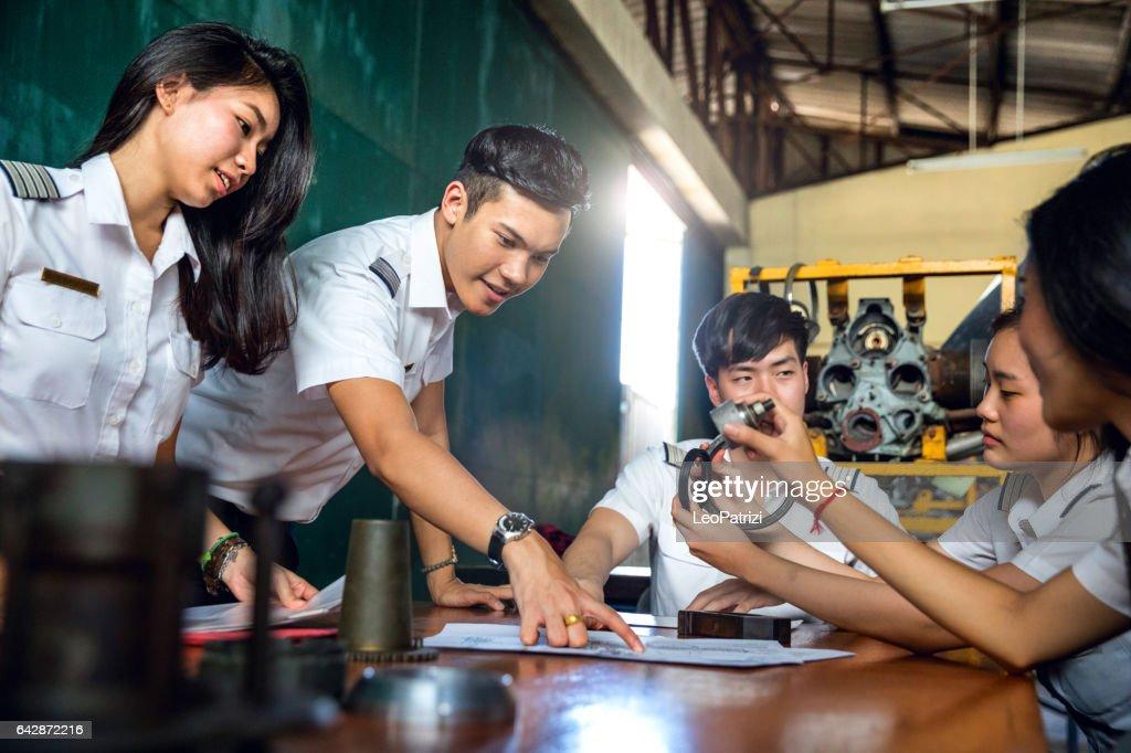Aviation University students attending to class : Stock Photo