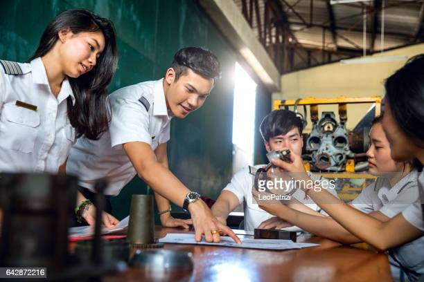 aviation university students attending to class - education building stock pictures, royalty-free photos & images