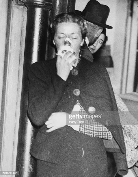 Aviator Amy Mollison holding a handkerchief to her injured nose with her other arm in a sling following a crash arriving back home at Gate House...