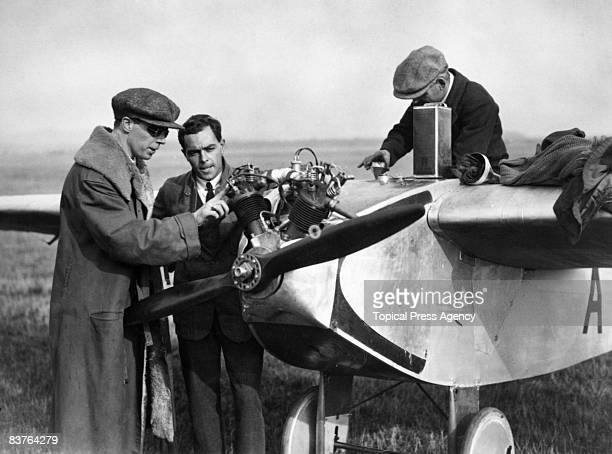 Aviator and inventor Bert Hinkler and Professor Lowe examine an Avro monoplane motorglider during the light aircraft trials at Lympne in Kent October...
