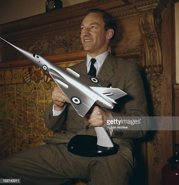 Aviator Peter Twiss pictured with the model of the Fairey Delta 2 'Droop Shoot', circa 1956. Twiss piloted the plane which was the first to exceed...
