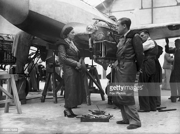 Aviators Amy and Jim Mollison examine an aircraft at Hatfield Aerodrome before a flight from England to Australia in the MacRobertson Air Race 2nd...