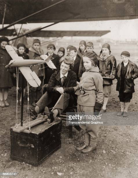 Aviatrix Amelia Earhart discusses aeronautics with young students from Newark New Jersey in November in 1933