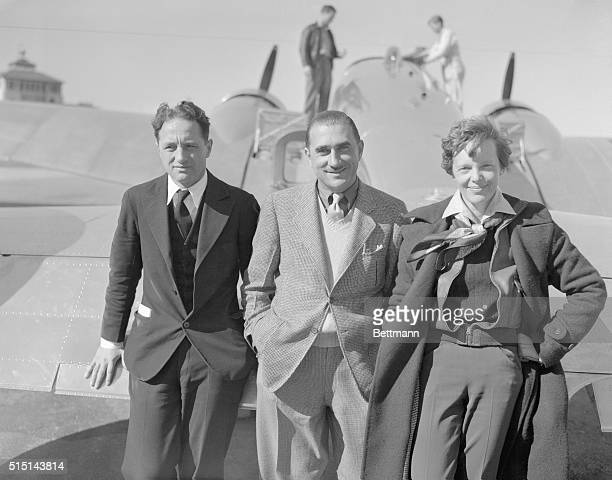Aviatrix Pilots Friends in Continental Hop Amelia Earhart noted aviatrix with a party of friends before taking off from Union Air Terminal Glendale...