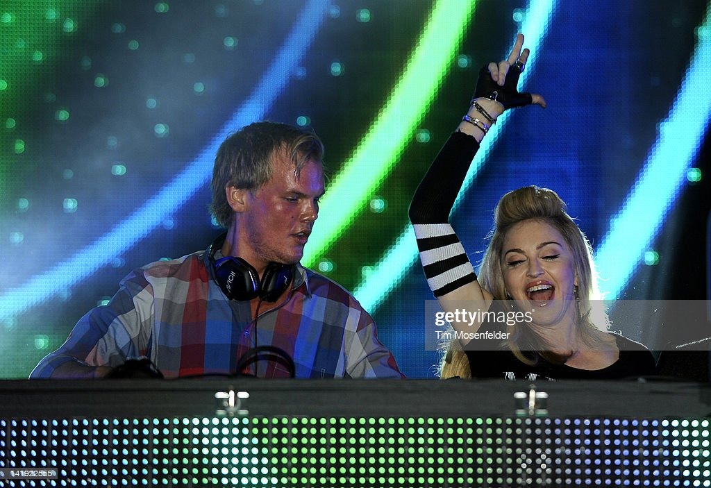 Avicii is joined by Madonna at Day Two of Ultra Music Festival 14 at Bayfront Park on March 24, 2012 in Miami, Florida.