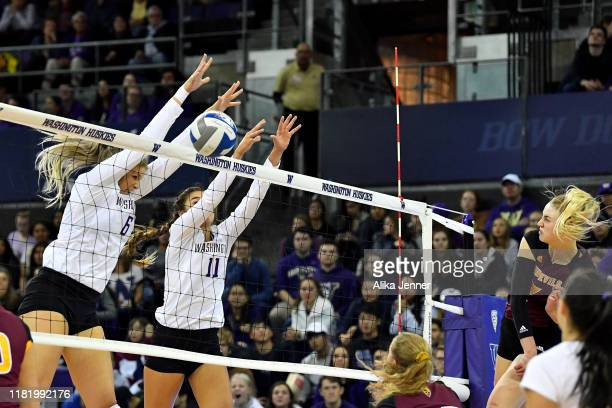 Avie Niece and Shannon Crenshaw of Washington Huskies block Claire Kovensky of the Arizona State Sun Devils during the match at Alaska Airlines Arena...