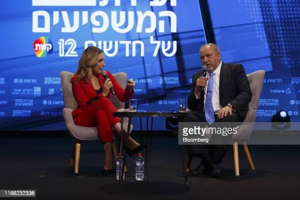 Avigdor Liberman former Israeli defense minister right speaks during an interview at the Channel 12 News Conference in Tel Aviv Israel on Thursday...