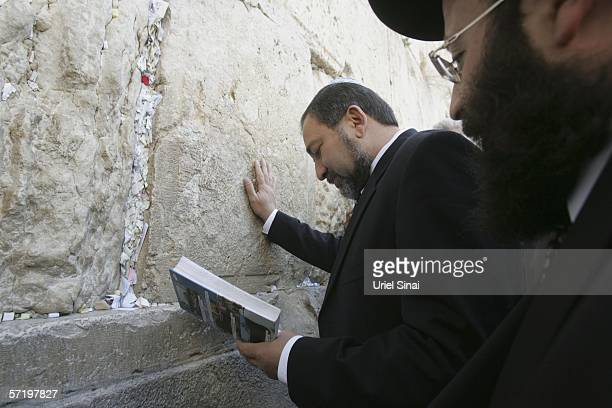 Avigdor Lieberman head of the Israeli party Yisrael Beitenu prays at Western Wall Judaism's holiest site March 2006 in Jerusalem's Old City Israel...