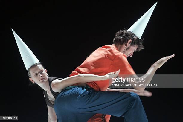Dancers perform a scene from Soit le puits etait profond soient ils tombaient tres lentement car ils eurent le temps de regarder tout autour by...