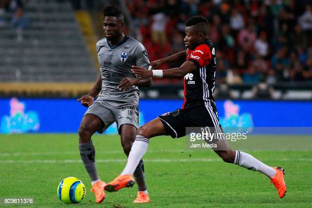 Aviles Hurtado of Monterrey and Clifford Aboagye of Atlas compete for the ball during the 9th round match between Atlas and Monterrey as part of the...