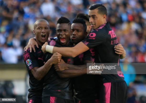 Aviles Hurtado of Monterrey celebrates with teammates after scoring his team's first goal during the 12th round match between Queretaro and Monterrey...