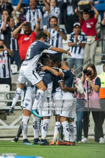 Aviles Hurtado of Monterrey celebrates with teammates after scoring his team´s third goal during the quarter finals second leg match between Tigres...