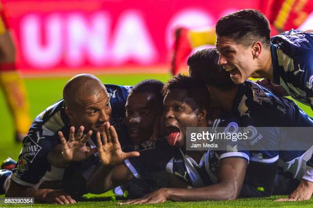 Aviles Hurtado of Monterrey celebrates with teammates after scoring the first goal of his team during the semifinal first leg match between Morelia...