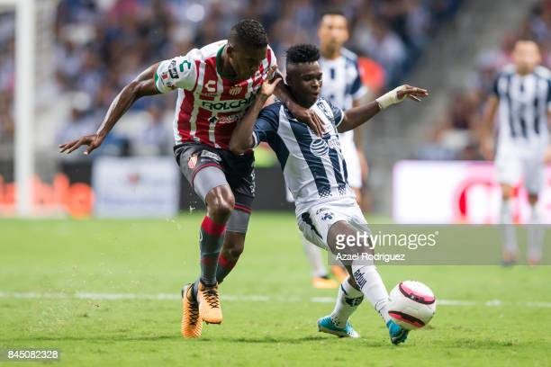 Aviles Hurtado of Monterrey fights for the ball with Brayan Beckeles of Necaxa during the 8th round match between Monterrey and Necaxa as part of the...