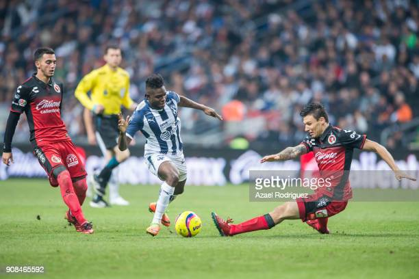 Aviles Hurtado of Monterrey fights for the ball with Damian Musto of Tijuana during the third round match between Monterrey and Tijuana as part of...
