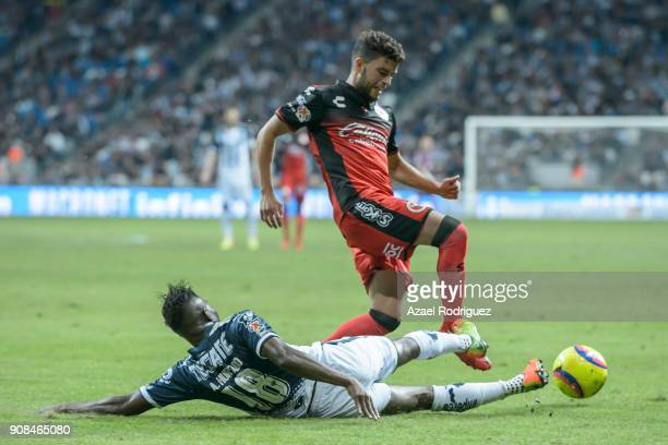Aviles Hurtado of Monterrey fights for the ball with Jose Rivero of Tijuana during the third round match between Monterrey and Tijuana as part of...