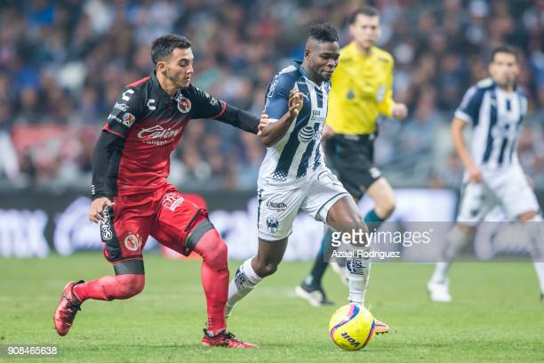 Aviles Hurtado of Monterrey fights for the ball with Luis Chavez of Tijuana during the third round match between Monterrey and Tijuana as part of...