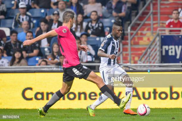 Aviles Hurtado of Monterrey fights for the ball with Omar Gonzalez of Pachuca during the Final match between Monterrey and Pachuca as part of the...