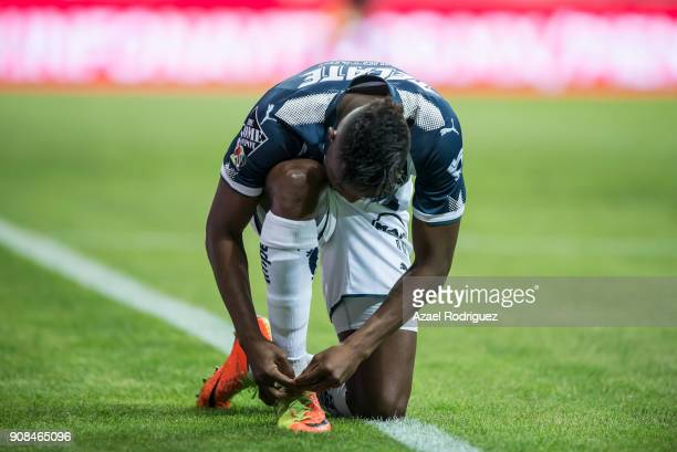 Aviles Hurtado of Monterrey fixes his shoelaces during the third round match between Monterrey and Tijuana as part of Torneo Clausura 2018 Liga MX at...