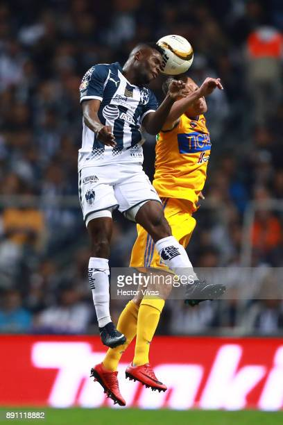 Aviles Hurtado of Monterrey goes for a header with Jesus Dueñas of Tigres during the second leg of the Torneo Apertura 2017 Liga MX final between...
