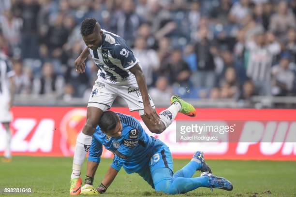 Aviles Hurtado of Monterrey jumps over Alfonso Blanco goalkeeper of Pachuca after scoring his team's first goal during the Final match between...