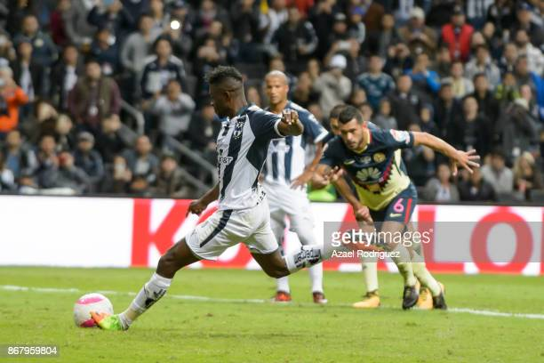 Aviles Hurtado of Monterrey kicks a penalty and scores his team' second goal during the 15th round match between Monterrey and America as part of the...