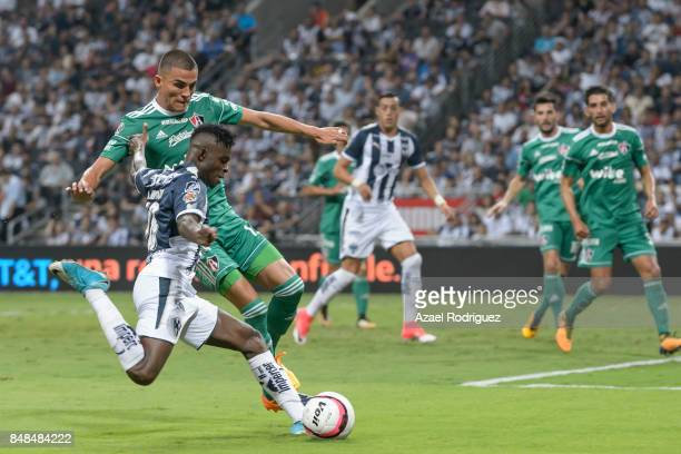 Aviles Hurtado of Monterrey kicks the ball over Luis Reyes of Atlas during the 9th round match between Monterrey and Atlas as part of the Torneo...