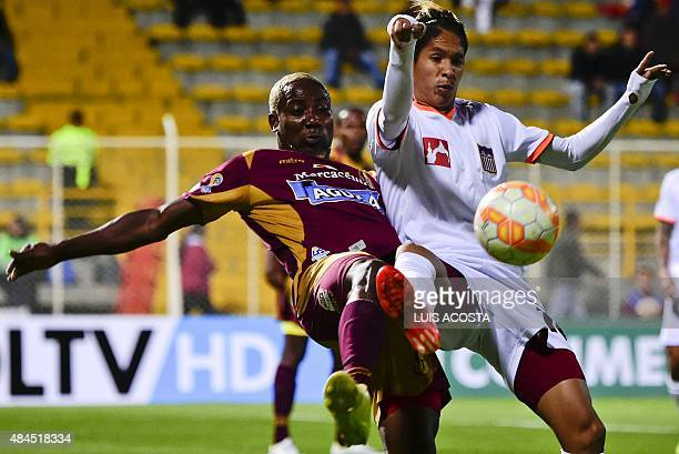 Avimiled Rivas of Colombia's Tolima vies for the ball with Aquiles Ocanto of Venezuela's Carabobo during their 2015 Copa Sudamericana football match...