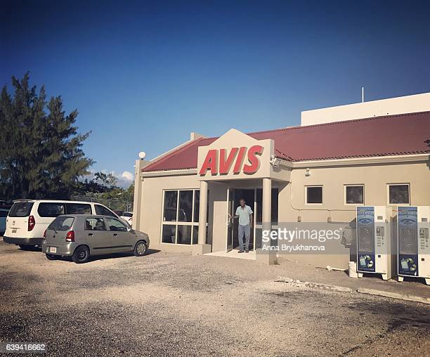 avis rent-a-car building in providenciales. turks and caicos islands - grand bahama stock photos and pictures