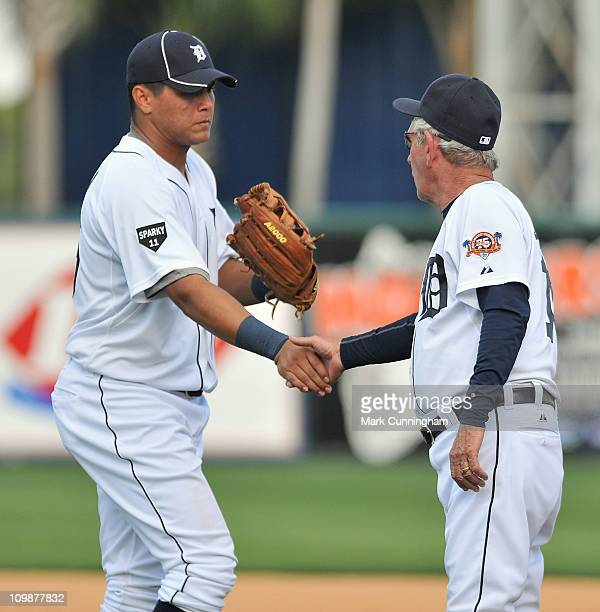 Avisail Garcia and Jim Leyland of the Detroit Tigers shake hands after the victory against the Florida Southern College Moccasins at Joker Marchant...