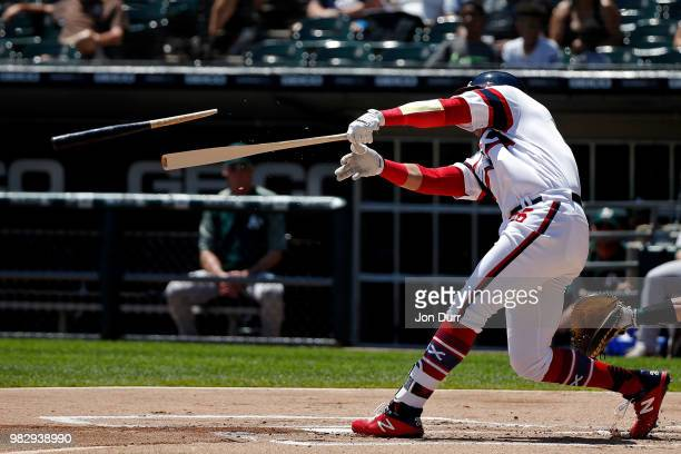 Avisail Garcia of the Chicago White Sox breaks his bat as he flies out against the Oakland Athletics during the first inning at Guaranteed Rate Field...